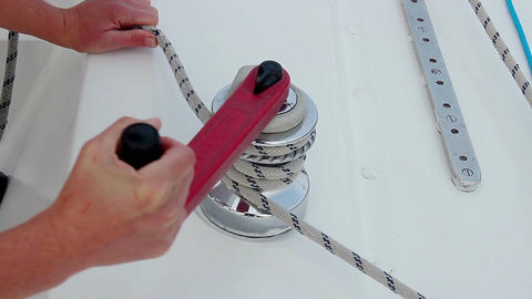 Sailor securing rope, mooring a sailboat, yachting, maintenance Footage