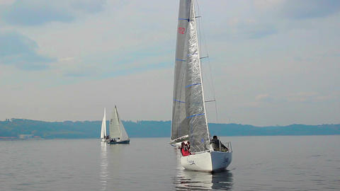 Beautiful sailing yachts in open sea, traveling, tourism, race Live Action