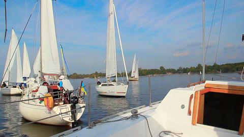 Sailboat making a turn, maneuvering among racing yachts, sport Footage