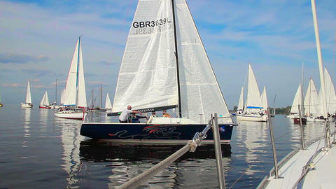Many racing yachts gathered in open sea, competition, sport Footage