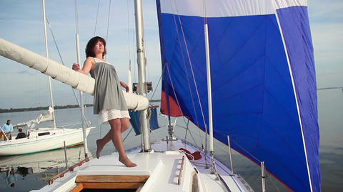 Attractive female enjoying summer vacation on sailing yacht Footage