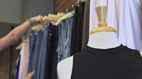 Woman browsing in a clothing store Footage