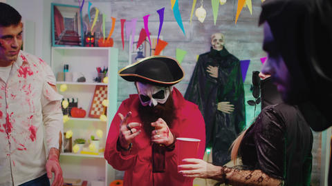 Cheerful man at halloween party dressed up like a pirate Live Action