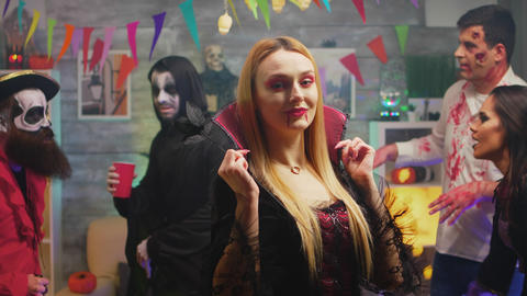 Sexy blonde in enchantress costume at halloween party Live Action
