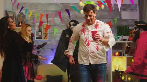 Drunk dangerous zombie celebrating halloween Live Action