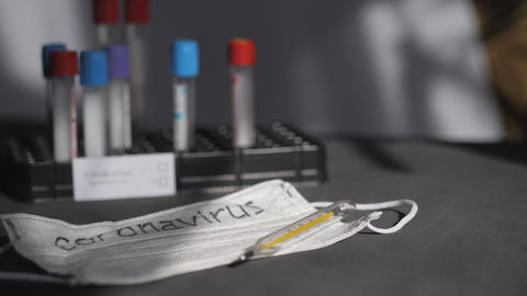 Coronavirus. Medical test tubes are in the organizer. Medical disposable gauze Live Action