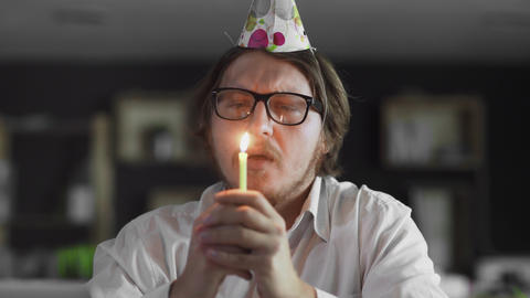 Sad manager celebrating a lonely birthday in the office Live Action