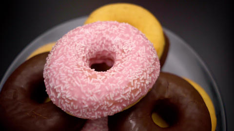 Selection of delicous Donuts on a plate Live Action