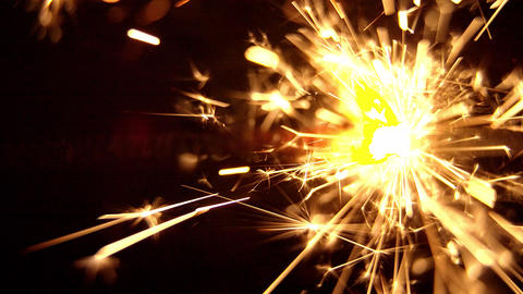 Burning sparkler candle in a Macro Shot Live Action