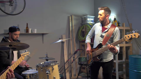 Slow motion video of music garage band having repetition Live Action