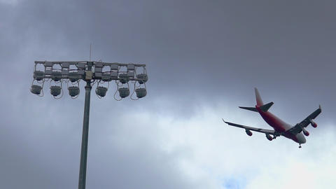 Commercial Passenger airliner jet arriving and landing at airport. SLOW MOTION Live Action