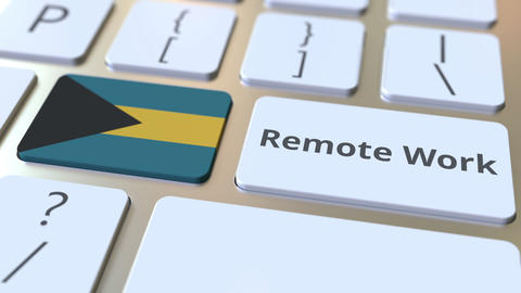 Remote Work text and flag of the Bahamas on the computer keyboard. Telecommuting ライブ動画