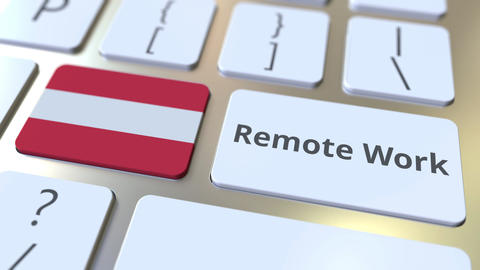 Remote Work text and flag of Austria on the computer keyboard. Telecommuting or ライブ動画
