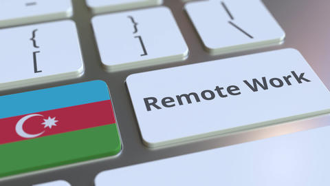 Remote Work text and flag of Azerbaijan on the computer keyboard. Telecommuting ライブ動画