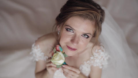 Beautiful, lovely bride in night gown and veil. Wedding morning. Wedding bouquet Live Action