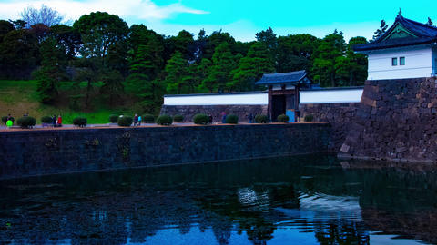A dusk timelapse at the imperial palace in Tokyo wide shot panning Live Action