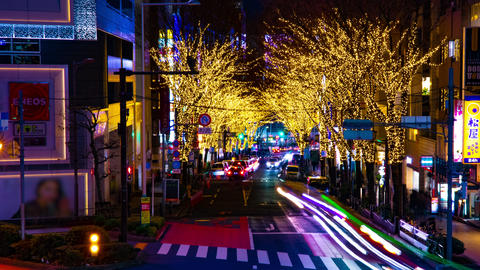 A night timelapse of the illuminated street at the downtown in Shibuya Tokyo Live Action