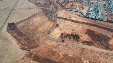 Top view drone construction cranes build apartment buildings dump trucks carry Live Action