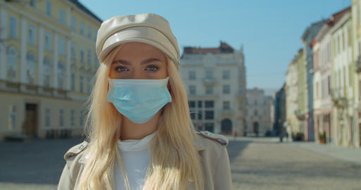 Beautiful blond Girl Wearing Medical Mask During Coronavirus in the center of an Live Action