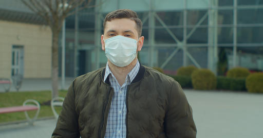 Man wearing protective mask near airport look.Concept of health and safety life Live Action