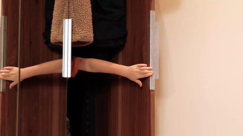 Little child hiding in wardrobe while playing at home Live Action