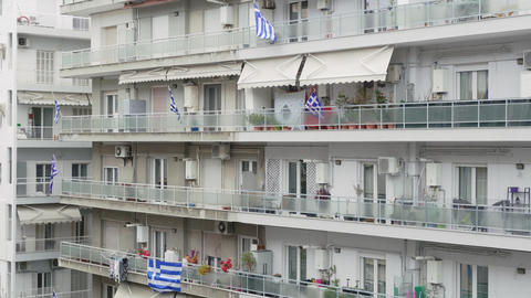 Real Greek flags waving on balconies for a national celebration Live Action