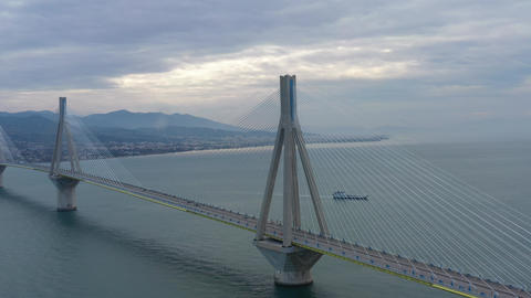 Aerial view of long cable-stayed Rio bridge in Greece at clouds weather, Ferry Live Action