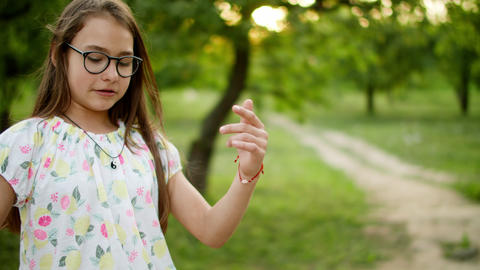 Smiling teenage girl dancing outside. Cheerful girs having fun otdoors Live Action