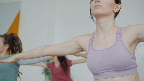 Attractive woman doing exercises moving body during yoga practice in sports Live Action