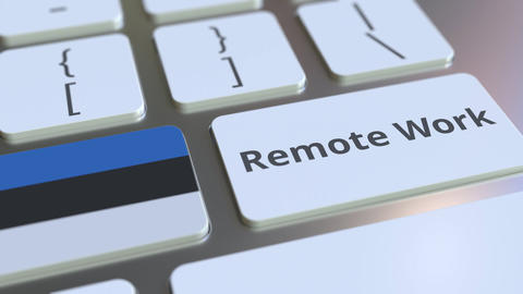 Remote Work text and flag of Estonia on the computer keyboard. Telecommuting or Live Action