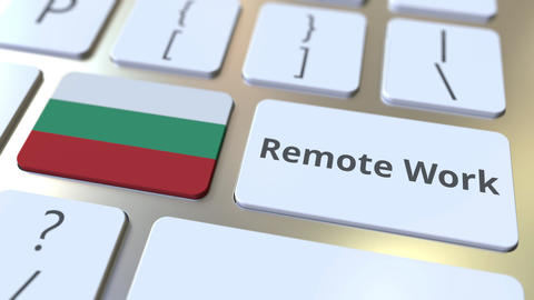 Remote Work text and flag of Bulgaria on the computer keyboard. Telecommuting or Live Action