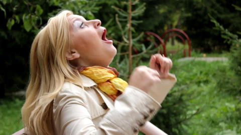woman hardly sneezing outdoors Live Action
