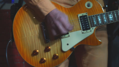 Guitar in the hands of the guitarist. The guitarist plays the guitar Live Action