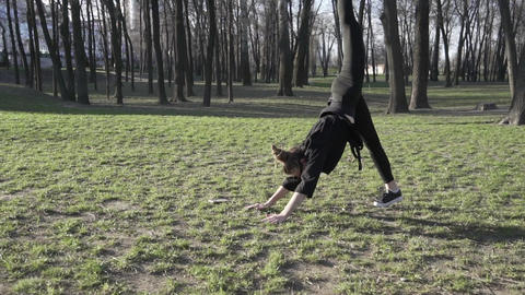 Healthy young asian woman exercising at park. Fit young person doing training Live Action