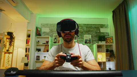Pov of professional gamer wearing virtual reality headset Live Action