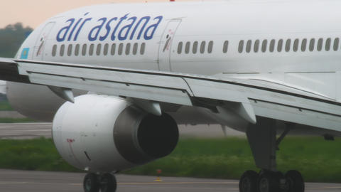 Air Astana Boeing 757 slowing after landing at rainy weather Live Action