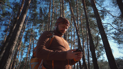 theme tourism and technology. Young caucasian man with beard and backpack Live Action