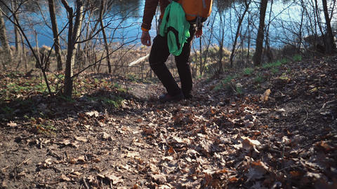 The theme of tourism and travel in nature. Caucasian man with a backpack hike Live Action