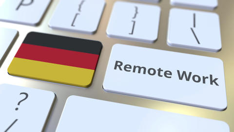 Remote Work text and flag of Gemany on the computer keyboard. Telecommuting or ライブ動画