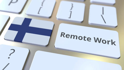 Remote Work text and flag of Finland on the computer keyboard. Telecommuting or Live Action