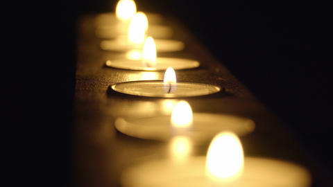 Candles in a row - beautiful macro shot Live Action