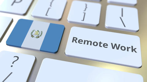 Remote Work text and flag of Guatemala on the computer keyboard. Telecommuting ライブ動画