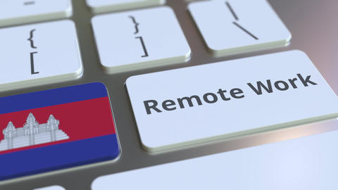 Remote Work text and flag of Cambodia on the computer keyboard. Telecommuting or Live Action