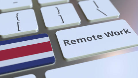 Remote Work text and flag of Costa Rica on the computer keyboard. Telecommuting ライブ動画