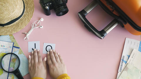 Top view hands laying on pink desk word JOURNEY Live Action