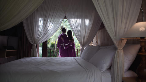 Young couple in robes hugging in a luxurious hotel Live Action