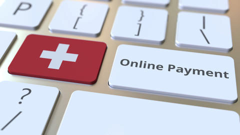 Online Payment text and flag of Switzerland on the keyboard. Modern finance Live Action