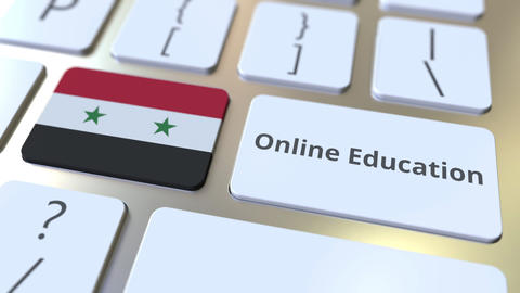 Online Education text and flag of Syria on the buttons on the computer keyboard Live Action