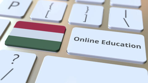 Online Education text and flag of Hungary on the buttons on the computer Live Action