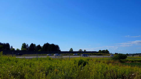 *Reverse Motion* Side View of Rural Highway During Bright Summer Day Backward Time Lapse. Beautiful Live Action